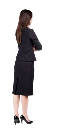 back view of thoughtful business woman contemplating. Young girl in suit.  Rear view people collection.  backside view of person.  Isolated over white background. photo