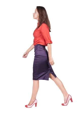 back view of walking woman in dress . going gir in motion. Rear view people collection.  backside view of person. Isolated over white background.