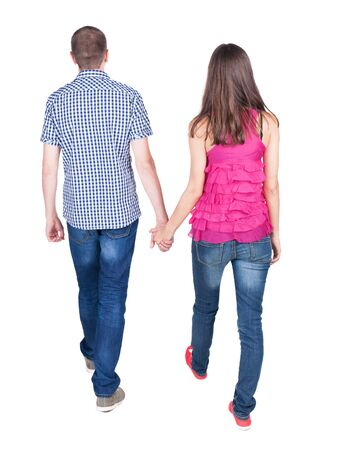 Back view of going young couple (man and woman). walking beautiful friendly girl and guy in jens. Rear view people collection. backside view of person.  Isolated over white background.  photo