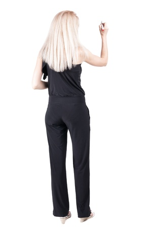back view of writing beautiful blonde woman. Young girl in jeans draws. Rear view people collection.  backside view of person. Isolated over white background. photo