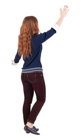 encounters: back view of walking  woman . beautiful redhead girl in motion.