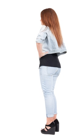 red head woman: back view of standing beautiful red head woman. Young redhead girl in jeas. Rear view. Isolated over white background