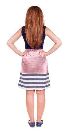 back view of standing young beautiful  woman.  redhead girl in red dress watching. Rear view people collection.  backside view of person.  Isolated over white background. photo