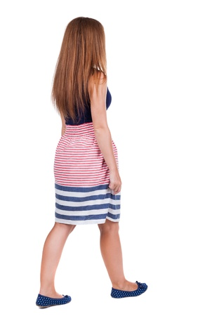 back view of walking  woman. beautiful redhead girl in motion.  backside view of person.  Rear view people collection. Isolated over white background.  photo