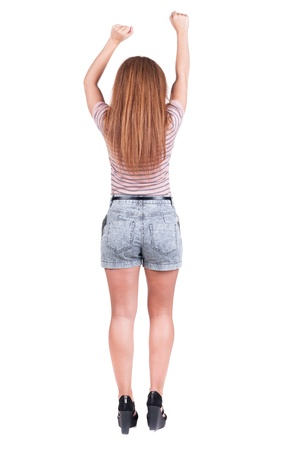 back view of standing young beautiful redhead woman thumbs up.  girl shows ok sign. Rear view people collection. backside view of person. Isolated over white background.  photo