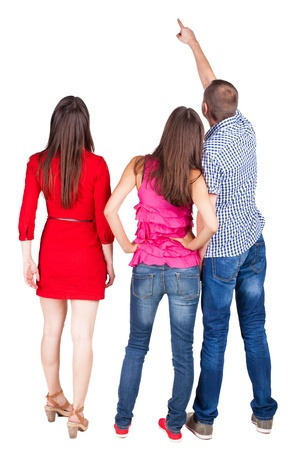 Back view of three friends. pointing man and two women looking. Rear view people collection.  backside view of person.  Isolated over white background.