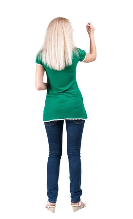 back view of writing beautiful blonde woman withred felt-tip pen. Young girl in jeans draws. Rear view people collection.  backside view of person. Isolated over white background. photo