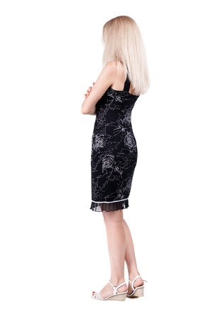 back view of standing young beautiful  blonde woman. girl  watching. Rear view people collection.  backside view of person.  Isolated over white background.  photo