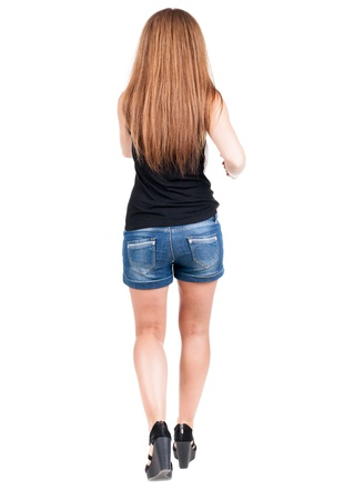 red head girl: back view of running  woman. beautiful red head girl in motion. backside view of person.  Rear view people collection. Isolated over white background. Stock Photo