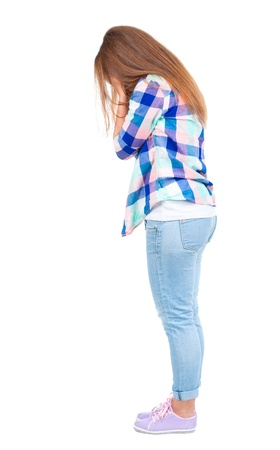 Back view of shocked woman in blue jeans jacket. girl hid his eyes behind his hands.  Rear view people collection.  backside view of person.  Isolated over white background. photo