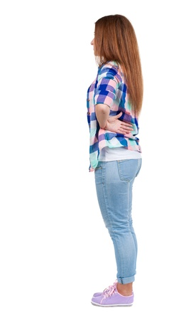 back view of standing young beautiful redhead woman. girl  watching. Rear view people collection.  backside view of person.  Isolated over white background.  photo