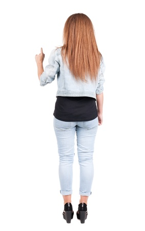 Back view of  pointing woman. beautiful redhead girl in jeans. Rear view people collection.  backside view of person.  Isolated over white background. photo