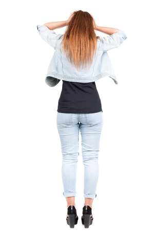 Back view of shocked redhead woman in jeans.   upset young girl. Rear view people collection.  backside view of person.  Isolated over white background. photo