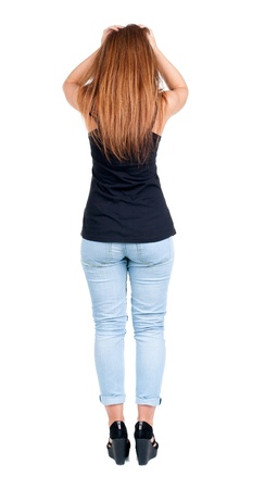 Back view of shocked woman in blue jeans. girl grabbed the hair. Rear view people collection.  backside view of person.  Isolated over white background. photo