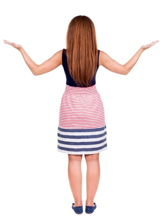 back view of surprised beautiful  redhead young woman with hands up. Girl in blue dress. Rear view people collection.  backside view of person.  Isolated over white background.  photo