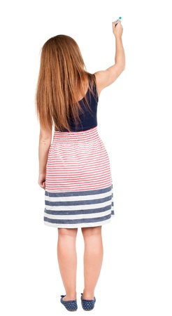 back view of writing beautiful redhead woman. Young girl in dress draws. Rear view people collection.  backside view of person. Isolated over white background. photo