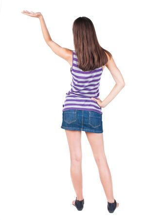 outrage: back view of surprised beautiful brunette young woman with hands up. Girl in blue dress. Rear view people collection.  backside view of person.  Isolated over white background.