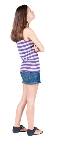 back view of standing young beautiful  brunette woman. girl  watching. Rear view people collection.  backside view of person.  Isolated over white background. Stock Photo - 21647030