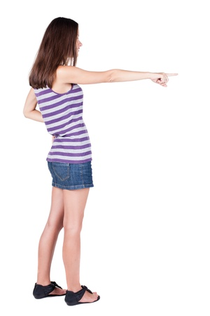 Back view of  pointing woman. beautiful brunette  girl.  Rear view people collection.  backside view of person.  Isolated over white background. photo