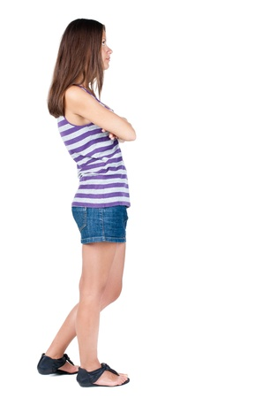 back view of standing young beautiful  brunette woman. girl  watching. Rear view people collection.  backside view of person.  Isolated over white background.  Stock Photo - 21647035