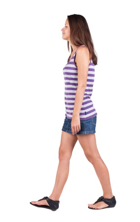 back view of walking woman . going gir in motion. Rear view people collection.  backside view of person. Isolated over white background. photo