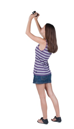 Back view of woman photographing. girl photographer in dress. Rear view people collection.  backside view of person.  Isolated over white background. photo