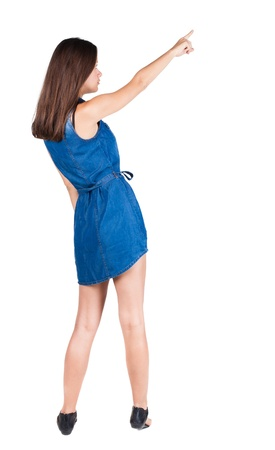 Back view of  pointing woman. beautiful brunette  girl in dress. Rear view people collection.  backside view of person.  Isolated over white background. photo
