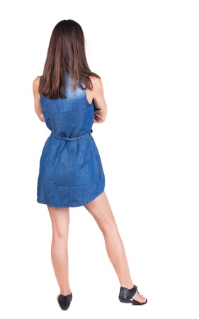 back view of standing young beautiful  woman.  brunette girl in red dress and  kitten heels watching. Rear view people collection.  backside view of person.  Isolated over white background. photo