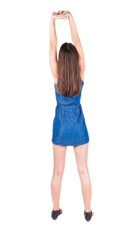 back view of young woman limber up.  brunette girl in red dress and  kitten heels watching. Rear view people collection.  backside view of person.  Isolated over white background. photo
