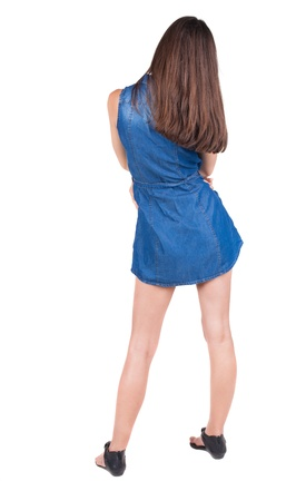 back view of standing young beautiful  woman. brunette girl head to one side watching. Rear view people collection.  backside view of person.  Isolated over white background. photo