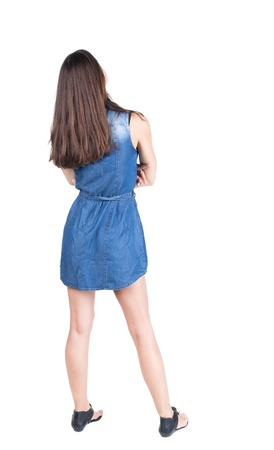 back view of standing young beautiful  brunette woman. girl  watching. Rear view people collection.  backside view of person.  Isolated over white background.  photo
