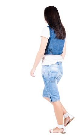 back view of walking  woman in shors. beautiful brunette girl in motion.  backside view of person.  Rear view people collection. Isolated over white background.  photo