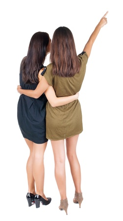 back view of businessteam. two young  business woman pointing.  Rear view people collection.  backside view of person.  Isolated over white background. photo