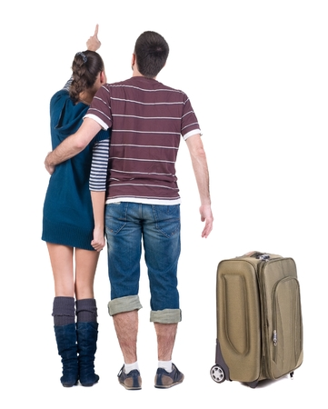 Young traveling couple with suitcas looks where that. Back view people. Isolated over white. Stock Photo - 22362936