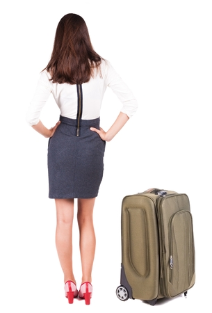 back view of traveling business woman with suitcas. Young girl in suit.  Rear view people collection.  backside view of person.  Isolated over white background. photo