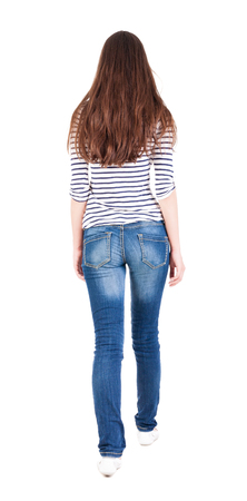 back view of walking  woman in jeans . beautiful brunette girl in motion.  backside view of person.  Rear view people collection. Isolated over white background.  photo