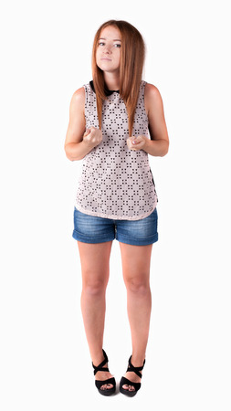 Red-haired teen girl in shorts. isolated on white background photo