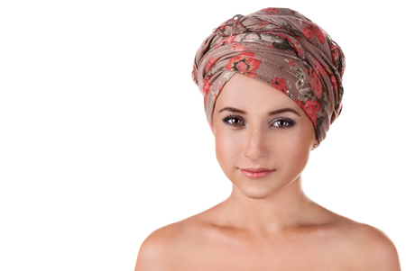 portrait of white-skinned girl in a turban. caucasian woman with freckles. Isolated on white background photo