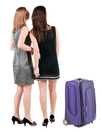 Two businesswoman traveling with suitcase. photo