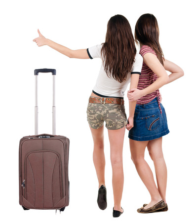 Two friends traveling with suitcase. photo