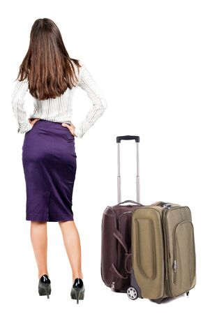 back view of standing young beautiful  brunette woman with backpack.  Stock Photo - 23163941