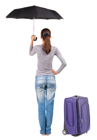 back view of woman with umbrella traveling with suitcase. Stock Photo - 23167071