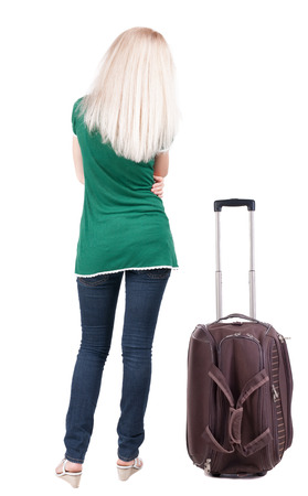 back view of standing young beautiful  brunette woman with backpack.