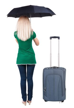 back view of woman standing with black umbrella traveling with suitcase. Stock Photo - 23167858