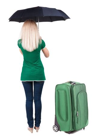 back view of woman standing with black umbrella traveling with suitcase. Stock Photo - 23167869