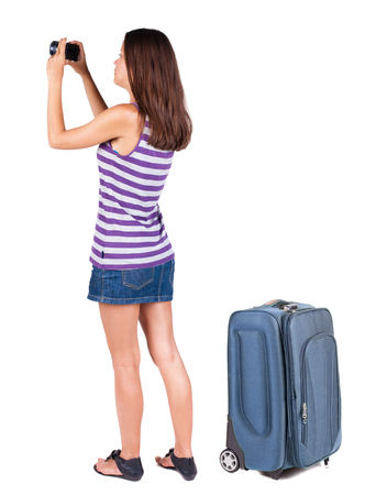 Back view of woman photographing traveling with suitcas. Rear view people collection.  backside view of person.  Isolated over white background.