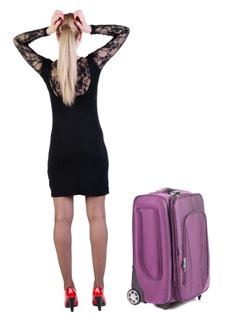 Back view of shocked business woman in dress traveling with suitcas .    Rear view people collection.  backside view of person.  Isolated over white background. photo