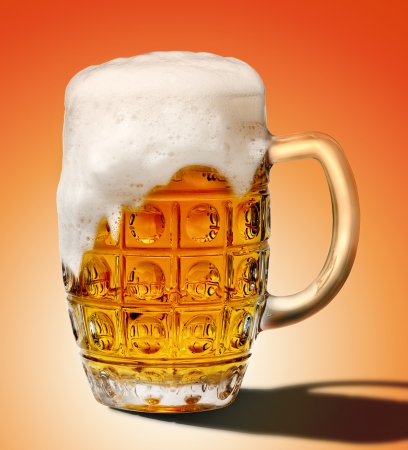 goblet of light beer foam. lager beer in a glass beaker with fresh bubbling foam. alcoholic fresh beverage  yellow color. pub drink. Isolated over white background. photo