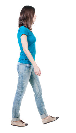 side shot: back view of walking  woman in jeans . beautiful brunette girl in motion.  backside view of person.  Rear view people collection. Isolated over white background.