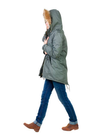 back view of walking  woman in warm jacket. beautiful brunette girl in motion.  backside view of person.  Rear view people collection. Isolated over white background. photo
